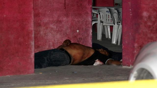 Policías Estatales, Tuzamapan, Sierra Norte, ejecutado, Secretaría de Seguridad Pública, cocina económica, cuerpo sin vida, paramédicos, bala, cabeza, cartuchos percutidos, Fiscalía General, occiso